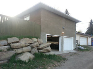 SE Acadia, bachelor suite with huge 2 car garage utilities incl.