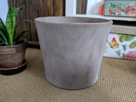 Large terracotta plant pot in grey