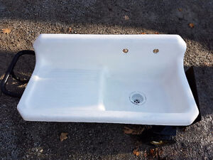 Vintage cast iron kitchen sink with drainboard and backsplash