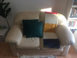 Leather two-person love seat (lightly used)