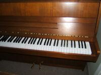 Kawai CX-4 upright piano on sale.