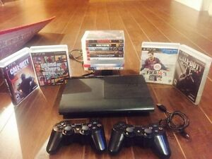 Sony playstation 3 slim - 500gb -15 games - 2 remotes West Island Greater Montréal image 1