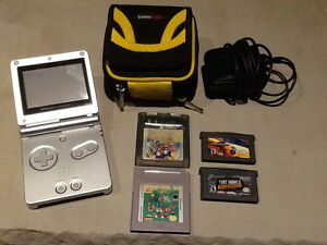 Nintendo Game Boy Advance SP with 4 games