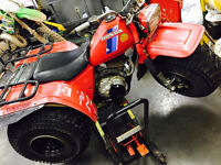 (HONDA BIG RED 200E) LOOKING TO TRADE !!!! FOR MOTOR CYCLE !!!