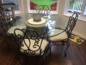 Beautiful wrought iron glass top table and matching chairs