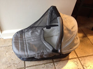 Uppa Baby gray bassinet with sunshade