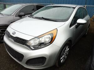2015 silver  KIA RIO   FREE CAR STARTER  HURRY IN