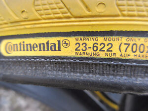 pair of continental tire grand prix 3000 size 700x23c.( $10}