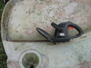 Electric lawn mower and hedge trimmer