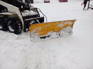 Snow plow for skid steer