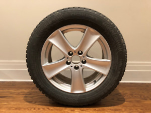"Four 18"" Nokian winter tires with rims"