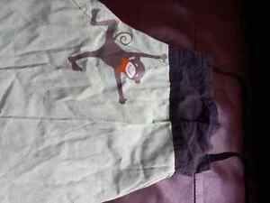 child's fabric apron with monkey design