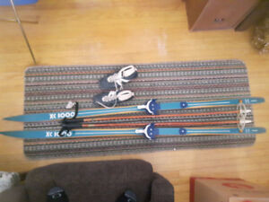 Vintage Pair of Skis with Poles and Shoes.