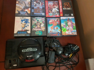 Sega Genesis 16 bit with cords and 8 games