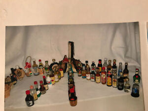 65 small empty liquor bottles