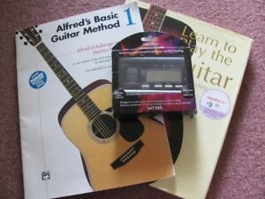 2 GUITAR BOOKS AND ONE SEIKO GUITAR AND BASS TUNER