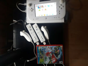 Wii U with Mario Kart and 2 Wii motes and 2 nunchuks!!!
