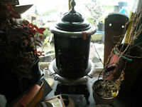 Newfoundland found Pot Belly Stove	white brass