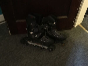 2 pairs hockey skates and 1 pair roller blades hunter boots