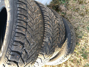Four Winter Tires size 205 65R 15 Goodyear ultragrip