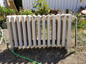 Weil-McLain Boiler and 8 cast iron radiators for sale