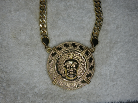 XL 9 Ct Gold Plated Medusa Pendant attached to large curb link