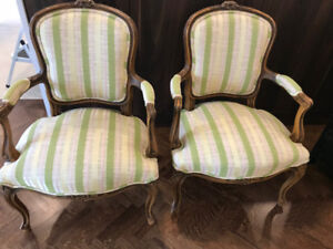 Pair of French antique walnut side chairs.