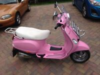 Vespa LX50 (limited edition rosa pink colour)