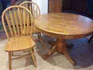 solid wood pedestal table with chairs