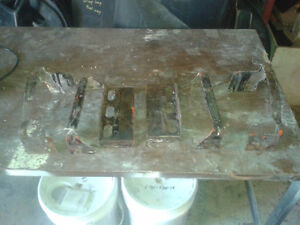 Original used front grill brackets off a 1971-74 Dodge Charger