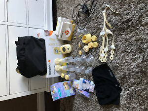 Medela freestyle breastpump + double flang pumping bra