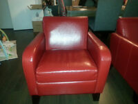 2 red leather sofa chairs in perfect condition
