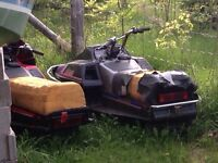 2 old snowmobiles