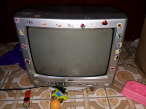 Mixed box and small old tv