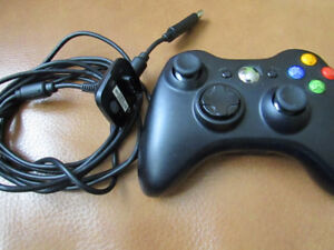 Black Xbox 360 controller with charging cable