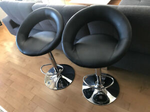 Two black leather bar stools