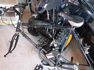 Two 66cc gas powered bicycles