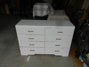 White dresser with 8 drawers.