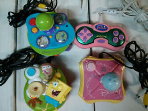 Plug in and play video games lot of 4 Pixar, Littlest Pet Shop,