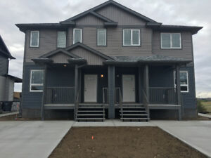 New and Spacious 4Plex Suite in Ranchlands!