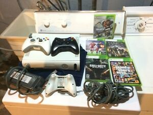 Selling my xbox 360, 3 remotes and 4 games gta v 70$ OBO