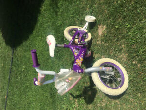 Girl's bike with training wheels/carry on bag and helmet