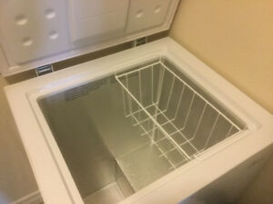 COMPACT, EFFICIENT, MINIMALLY USED CHEST FREEZER,