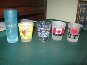 FIVE DIFFERENT SHOT GLASSES.