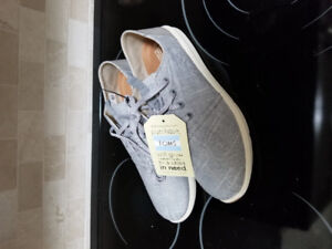 Mens TOMS shoes size 10. Never worn.