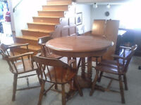 Excellent diningroom table ,4chairs and a captains chair