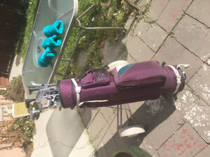 Golf bag with Cart and various clubs
