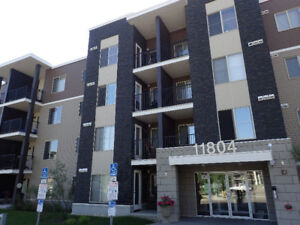 Great 2 bedroom + den unit steps away from amenities and trails