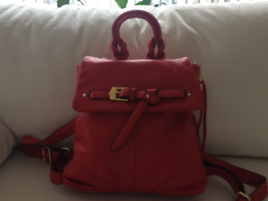 Brand new red leather backpack