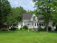 Country Living with beautiful view of lake and 80+ acres of wood